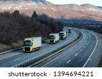 caravan or convoy of yellow... | Shutterstock . vector #1394694221