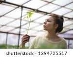 white farmer girl working in... | Shutterstock . vector #1394725517