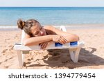 pretty woman is sunbathing on... | Shutterstock . vector #1394779454