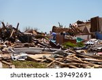 Small photo of MOORE, OKLAHOMA (USA) - MAY 20th 2013. EF5 tornado strikes the city of Moore, Oklahoma. The whole town is abolished. These images show the heavy damage. Moore, Oklahoma (USA) - May 20th 2013.