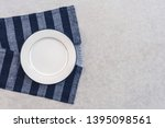 white plate and striped... | Shutterstock . vector #1395098561