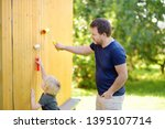 little boy preparing to paint... | Shutterstock . vector #1395107714