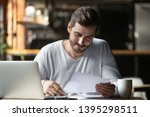 Cheerful Man Doing Paperwork I...