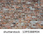 old obsolete red brick wall... | Shutterstock . vector #1395388904