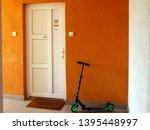 white pvc vinyl entrance door... | Shutterstock . vector #1395448997