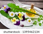 Small photo of Fresh salad with various eatable flowers