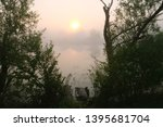 foggy morning. dawn outside the ... | Shutterstock . vector #1395681704