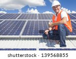 solar panel technician on roof | Shutterstock . vector #139568855