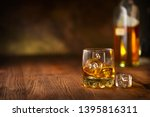 whiskey with ice cubes. glass... | Shutterstock . vector #1395816311