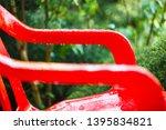 red plastic garden chairs on... | Shutterstock . vector #1395834821