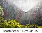 irrigation system sprays water... | Shutterstock . vector #1395834827