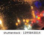 bokeh night city lights behind... | Shutterstock . vector #1395843014