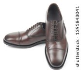 classic men's brown shoes on... | Shutterstock . vector #1395843041