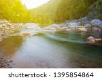 beautiful mountain river... | Shutterstock . vector #1395854864