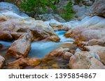 mountain river rushing through... | Shutterstock . vector #1395854867