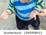 cute little toddler boy showing ... | Shutterstock . vector #1395908411