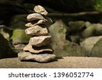 cairn stones carefully balanced ... | Shutterstock . vector #1396052774