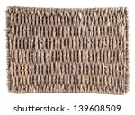Brown wicker coaster isolated over white background - stock photo