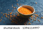 red lentils in a bowl close up... | Shutterstock . vector #1396114997