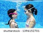 Children Swim In Swimming Pool...