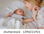 young beautiful mother with her ... | Shutterstock . vector #1396211921