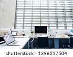 an interior of desks with... | Shutterstock . vector #1396217504