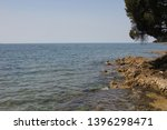 view to rocks  adriatic sea and ... | Shutterstock . vector #1396298471