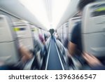 Small photo of aerophobias concept. plane shakes during turbulence flying air hole. Blur image commercial plane moving fast downwards. Fear of flying. collapse slump, depression, downfall, debacle, subsidence. dive