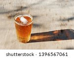 close up on a pint glass of... | Shutterstock . vector #1396567061