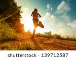 young lady running on a rural... | Shutterstock . vector #139712587