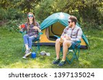 Stock photo people tourism and nature concept couple having fun on camping trip and play with cat 1397135024