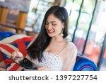 portrait of woman reading a... | Shutterstock . vector #1397227754