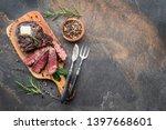 medium rare ribeye steak with... | Shutterstock . vector #1397668601