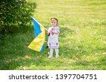 child carries fluttering blue... | Shutterstock . vector #1397704751