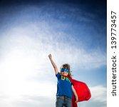 superhero kid against dramatic... | Shutterstock . vector #139773457