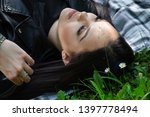 a positive woman lying down on... | Shutterstock . vector #1397778494
