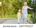 beautiful granny and her little ... | Shutterstock . vector #1397793227