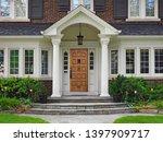 Elegant Wooden Front Door Of...