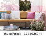 Colorful Pillows On Rattan Sof...