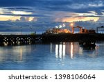 evening light from the old... | Shutterstock . vector #1398106064