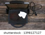 dirty electric grill wiping... | Shutterstock . vector #1398127127