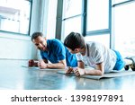 father and son doing plank... | Shutterstock . vector #1398197891