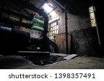 dark gloomy interior pump house | Shutterstock . vector #1398357491