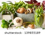 Fresh vegetables and aromatic herbs on a white background. - stock photo