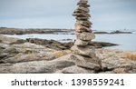 cairn on a hiking trail on the... | Shutterstock . vector #1398559241