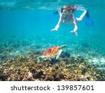 child snorkeling in a tropical... | Shutterstock . vector #139857601