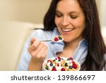 relaxed woman eating bowl of... | Shutterstock . vector #139866697