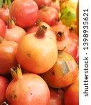 fresh pomegranate fruits for... | Shutterstock . vector #1398935621