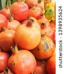 fresh pomegranate fruits for... | Shutterstock . vector #1398935624