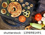 grilled sausage and vegetables... | Shutterstock . vector #1398981491